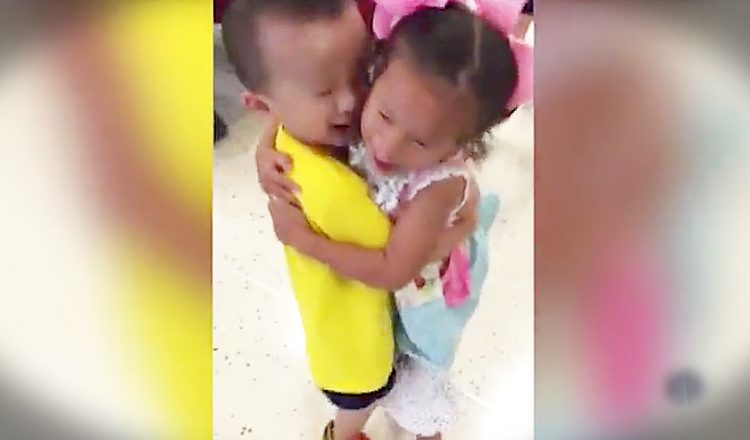 toddler orphans hug each other after being adopted