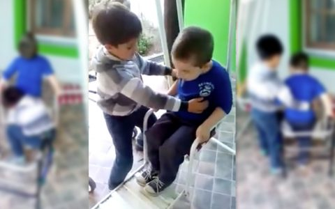little boy helps best friend