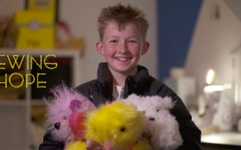 boy sews bears for kids in hospital