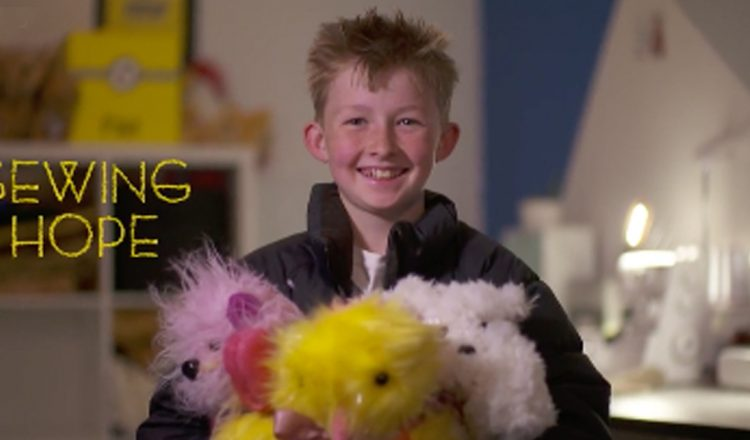boy sews bears for kids in hospital