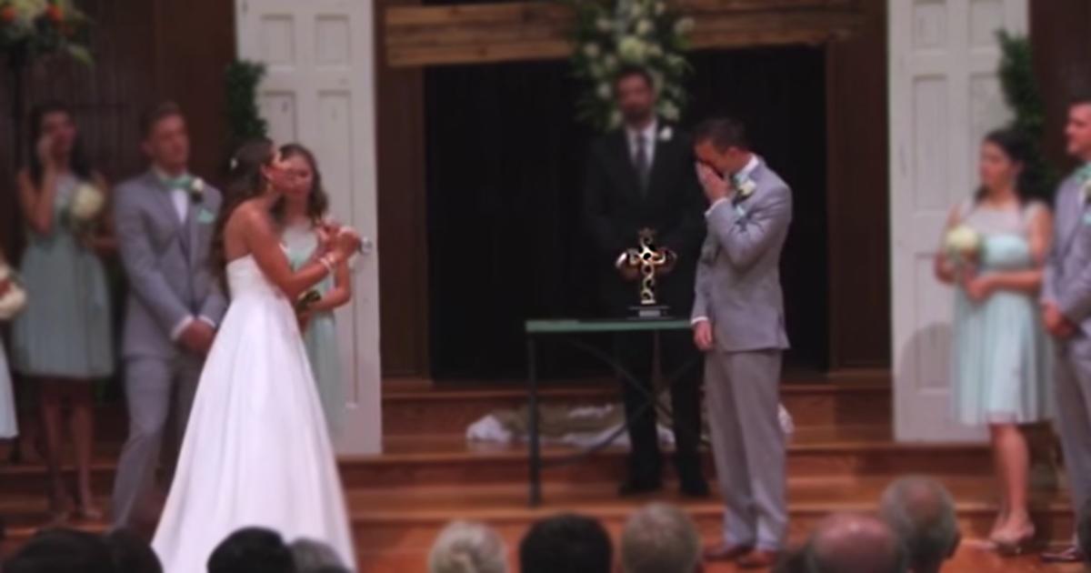 bride backs away - signs at wedding