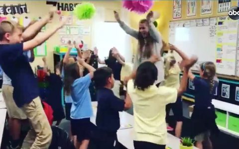 musical morning motivation - teacher raps with students in classroom