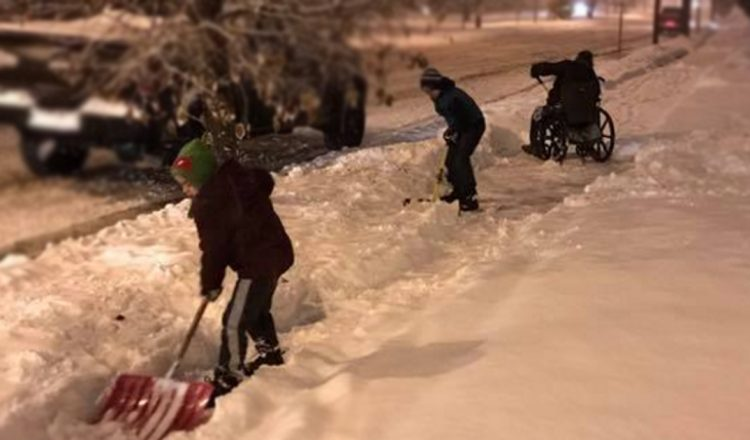 dad pulled over snow shovel wheelchair