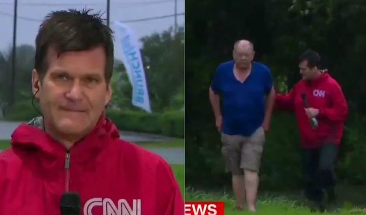 Reporters Stop Their Live Broadcast To Rescue Man In Flooded Truck_ everything inspirational